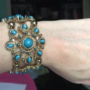Jewelry - NWOT-Bracelet with stretch band. Gold and teal